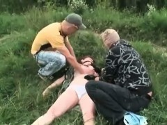 Two dudes abusing brunette...